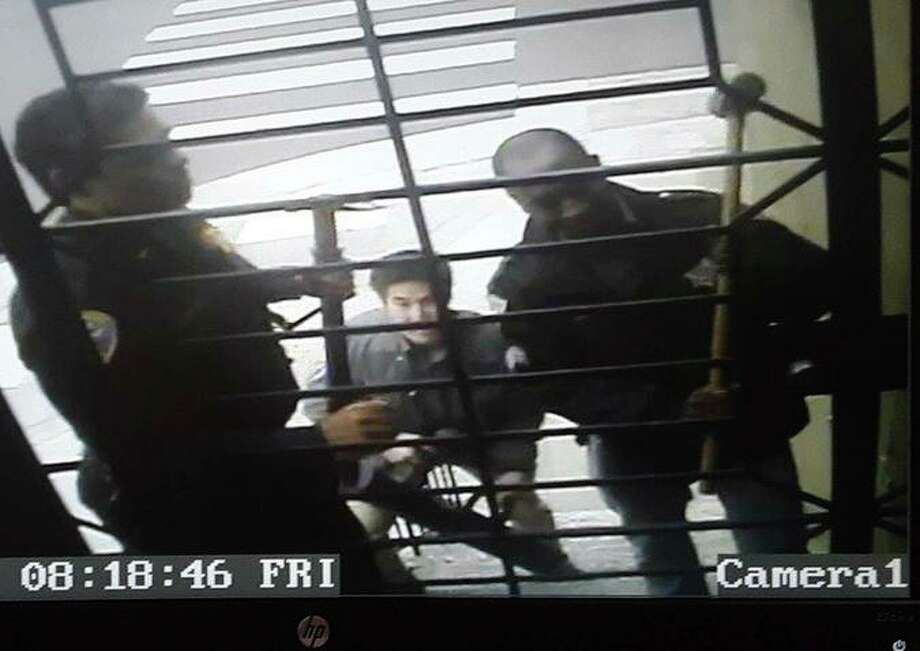 Security video shows San Francisco police sledgehammerin the front gate of Bryan Carmody's home while executing a search warrant on May 10, 2019. An internal memo released this week shows that officers were told to turn off their body-worn cameras before executing the warrant, which appears to be a violation of department policy. Photo: Courtesy Bryan Carmody