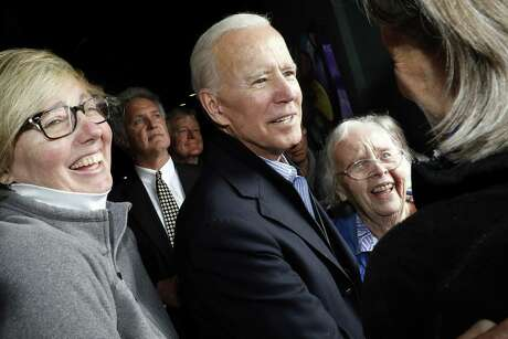 Former vice president and Democratic presidential candidate Joe Biden greets supporters during a campaign stop at the Community Oven restaurant in Hampton, N.H. on May 13, 2019.