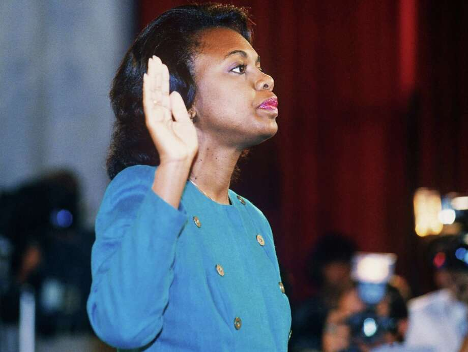 US law professor Anita Hill takes oath October 12, 1991, before the Senate Judiciary Committee in Washington D.C.. Hill filed sexual harassment charges against US Supreme Court nominee Clarence Thomas. Joe Biden chaired that committee, from which Democrats believe she didn't get a fair shake. Photo: Jennifer Law /TNS / Getty Images North America