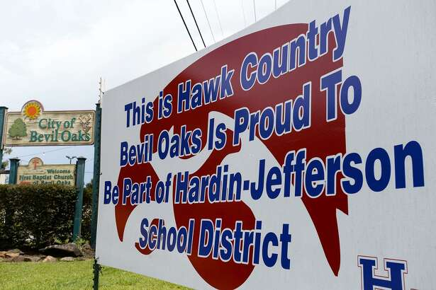 A sign along Texas 105 celebrates Bevil Oaks joining the Hardin-Jefferson school district. Photo taken Friday 8/10/18 Ryan Pelham/The Enterprise