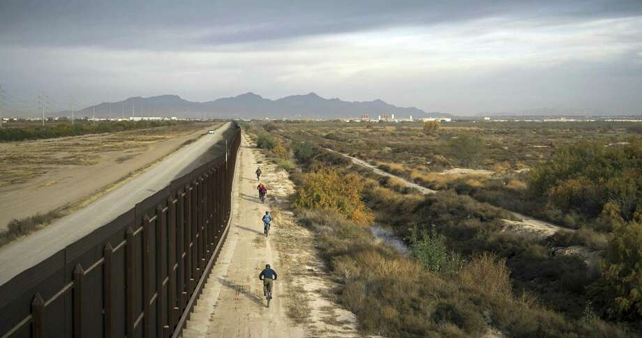 """In this January, 2018 photo released by Fin and Fur Films, a group of filmmakers and wildlife photographers cycle along the border wall near the U.S.-Mexico border south of Big Bend National Park, Texas. This portion of the wall is within the U.S., some distance from the actual border. The new documentary, """"The River and The Wall,"""" released Friday, May 3, 2019, examines the diverse wildlife and landscape of the Rio Grande along the U.S.-Mexico border. (Fin and Fur Films via AP) Photo: Associated Press / Fin And Fur Films"""
