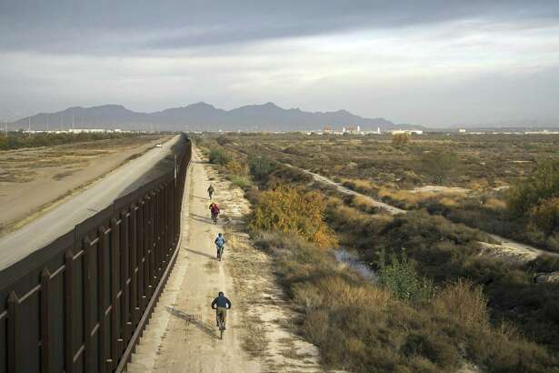 "In this January, 2018 photo released by Fin and Fur Films, a group of filmmakers and wildlife photographers cycle along the border wall near the U.S.-Mexico border south of Big Bend National Park, Texas. This portion of the wall is within the U.S., some distance from the actual border. The new documentary, ""The River and The Wall,"" released Friday, May 3, 2019, examines the diverse wildlife and landscape of the Rio Grande along the U.S.-Mexico border. (Fin and Fur Films via AP)"