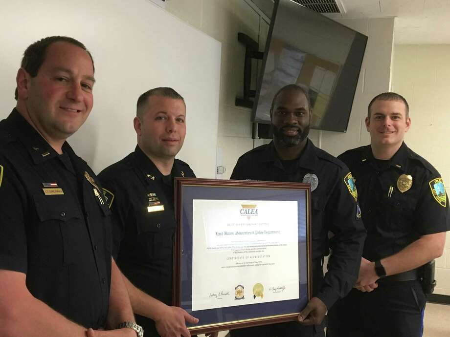 East Haven Chief of Police Edward R. Lennon, second from left, holds the department's CALEA certificate with, from left, Lt. David Emerman, Accreditation Manager Officer Hershen Bissette and Lt. Pat Tracy. Photo: Mark Zaretsky / Hearst Connecticut Media