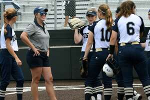Klein Collins Head Softball Coach Audra Troutman pumps up her team between innings of Game One of their Region II-6A Regional Quarterfinal Playoff Series matchup with Spring at Humble High School on May 9, 2019.