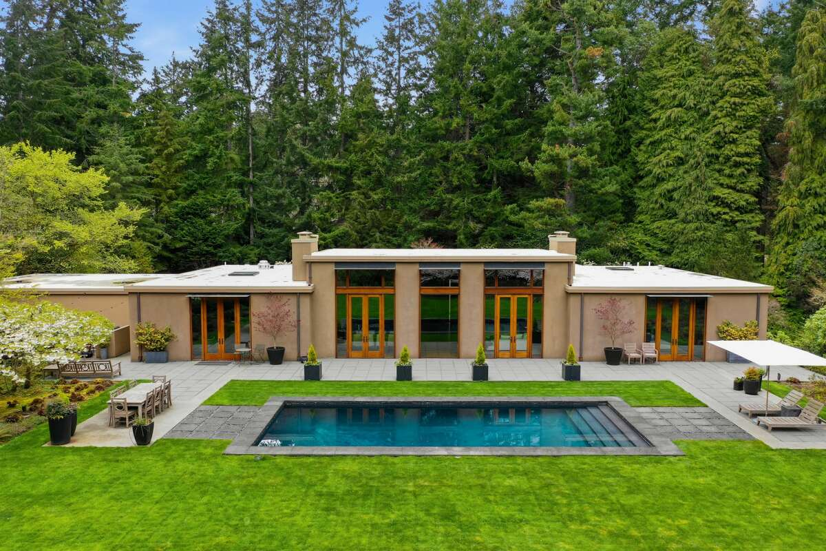 Inside the exclusive Highlands, this Kundig remodel is listed for $3.45M