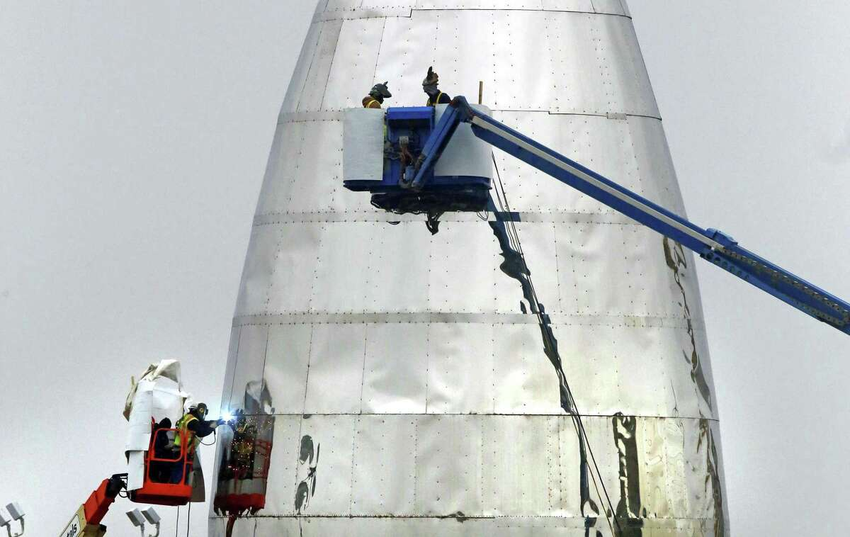 """SpaceX continues work on Jan. 2, 2019, on its prototype starship that is being called """"test hopper"""" at the Boca Chica Beach site, near Brownsville in South Texas. SpaceX CEO Elon Musk plans to launch a rocket to Mars by 2024."""
