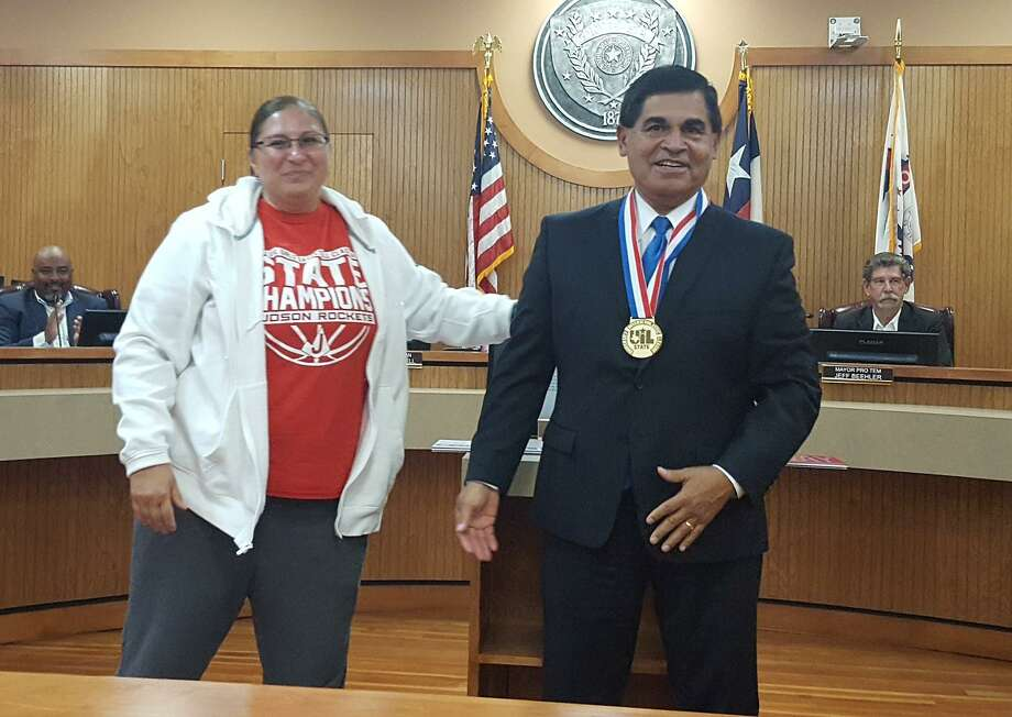 Converse Mayor Al Suarez beams after receiving a gold medal from Judson High School girls basketball coach Triva Corrales. Corrales presented the team medal to Suarez during a May 7 tribute to Suarez and his 12 years of service as the Converse mayor. Photo: Jeff B. Flinn / Staff