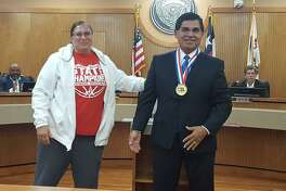 Converse Mayor Al Suarez beams after receiving a gold medal from Judson High School girls basketball coach Triva Corrales. Corrales presented the team medal to Suarez during a May 7 tribute to Suarez and his 12 years of service as the Converse mayor.