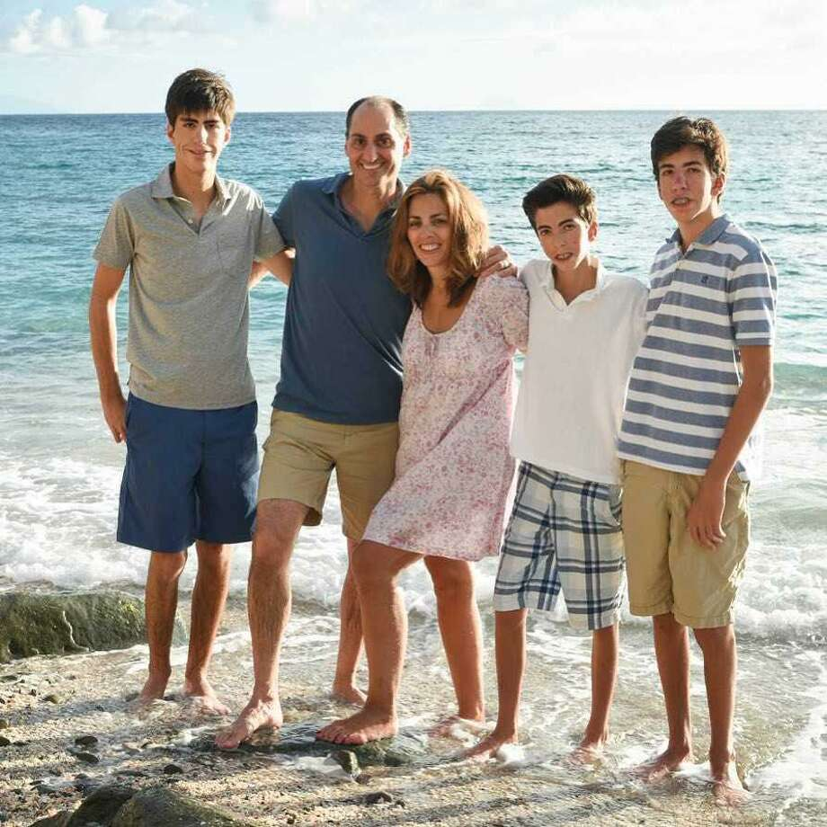 Lisa Lori of Greenwich began fundraising for Operation Smile after her three sons -- Zack (18), Luke (16), and Griffin (15) were born with physical challenges. Photo: Contributed