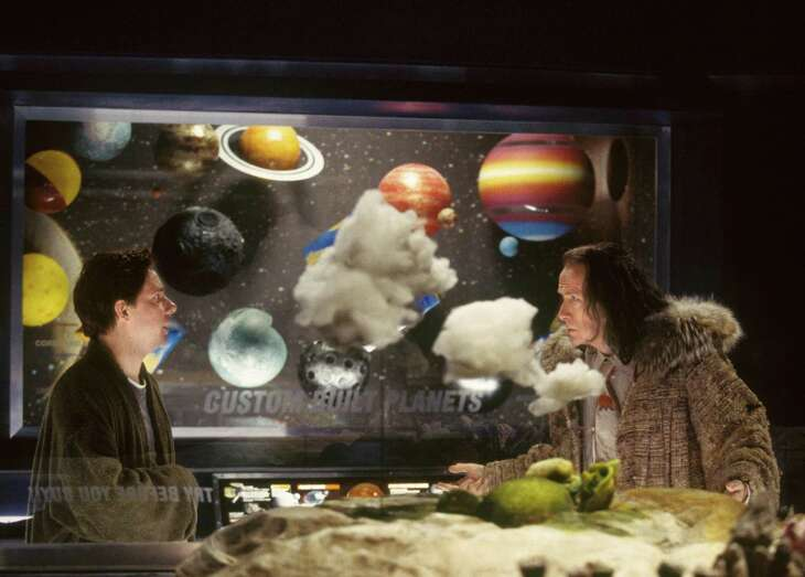 """Martin Freeman (left) as Arthur Dent and Bill Nighy as Slartibartfast in a scene from the film adaptation of Douglas Adams' """"The Hitchhiker's Guide to the Galaxy."""""""