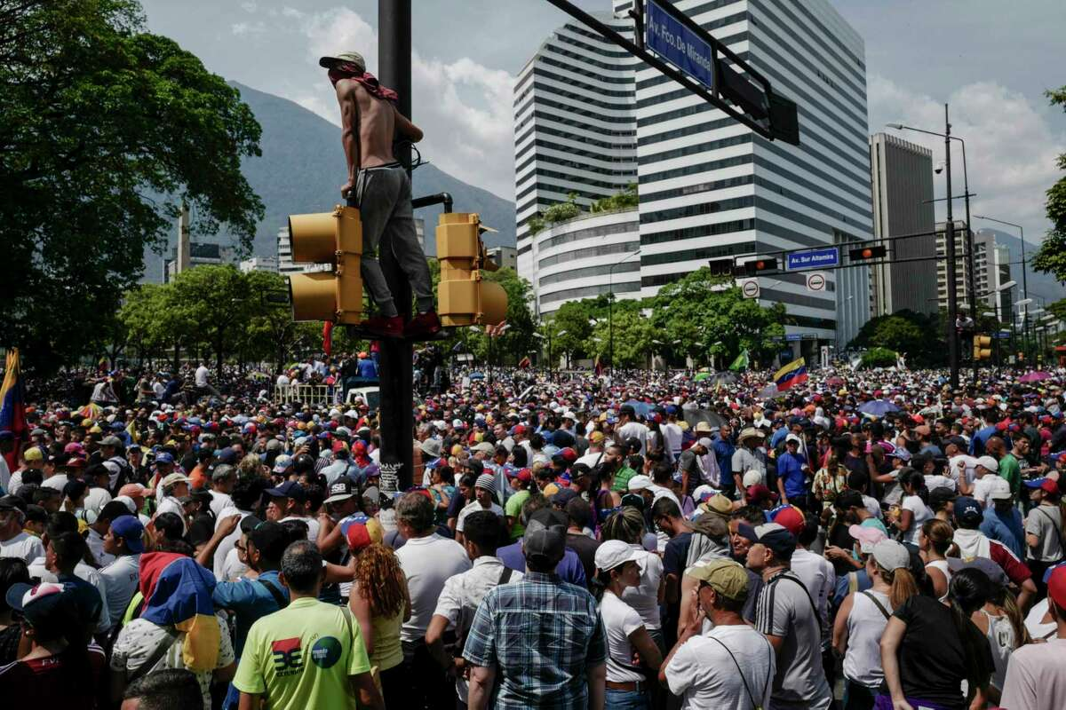 Thousands of supporters of the Venezuelan opposition gather May 1, 2019 to protest the Maduro government in the streets of Caracas, Venezuela.