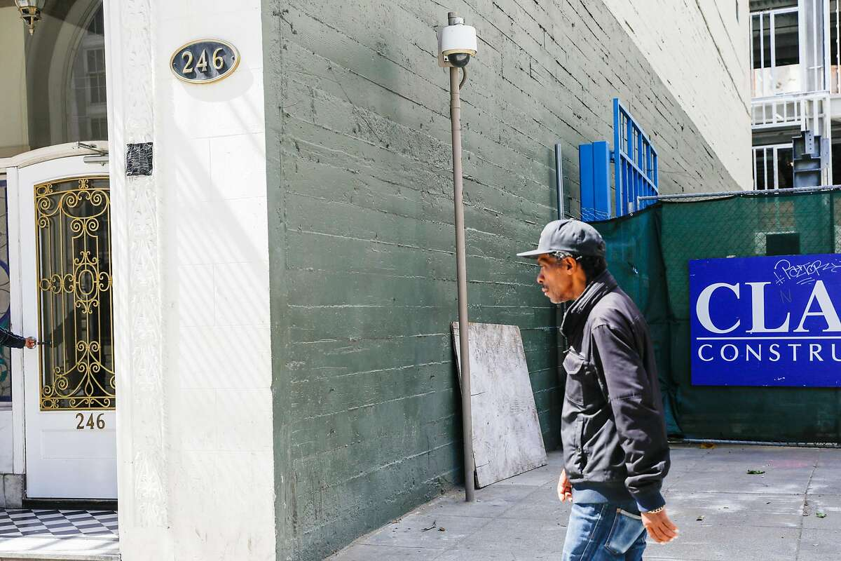 A man passes by a security camera on McAllister Street in San Francisco, California, on Monday, May 13, 2019. The Board of Supervisors is considering a proposal to ban city departments from using facial recognition software. While privacy advocates applaud the move, others say it will keep the city from a useful tool in crime solving. San Francisco law enforcement agencies such as the police department and District Attorney's office, say they do not use facial recognition software.