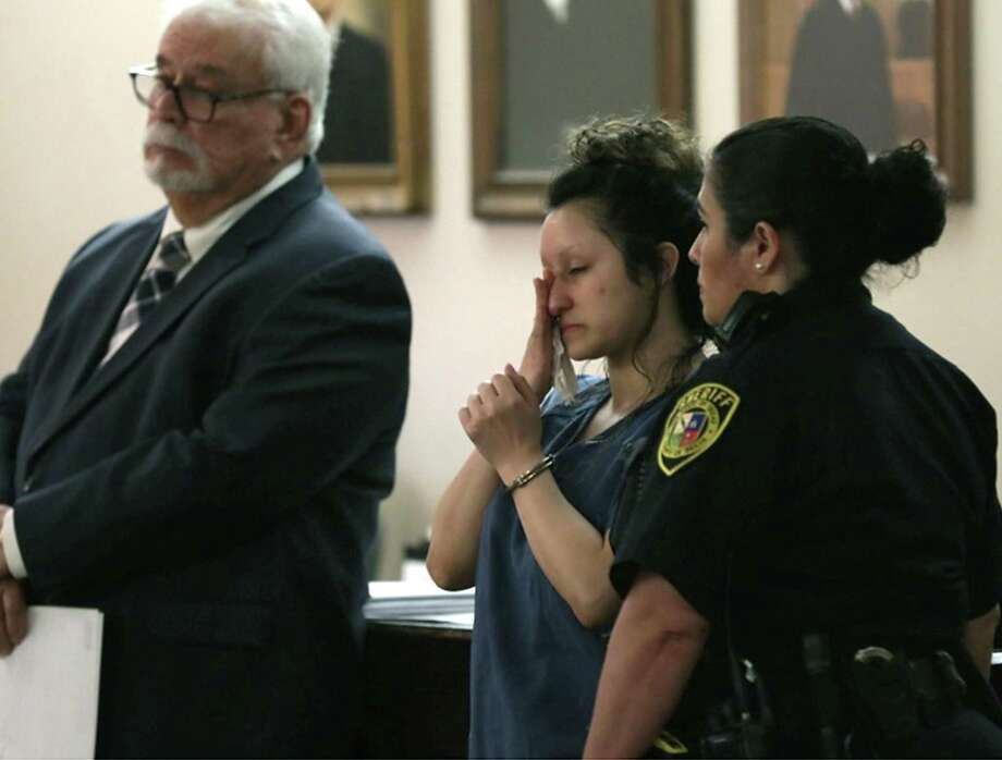 Laura Flores Messick, who was convicted of murdering her boyfriend, Chason Montez DeOca, wipes away tears as she listens to DeOca's mother Rachel Montez DeOca. Messick was sentenced to life in prison, in the 175th state District Court in the Cadena-Reeves Justice Center, by Judge Catherine Torres-Stahl on Monday, May 13, 2019. Photo: Bob Owen, Staff Photographer / Staff Photographer / ©2019 San Antonio Express-News