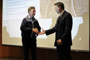 Gov. Ned Lamont shakes hands with Rep. Chris Perone, D-Norwalk. Lamont visited Norwalk with Representative Lucy Dathan, D-New Canaan and Perone on Monday for a transportation forum.