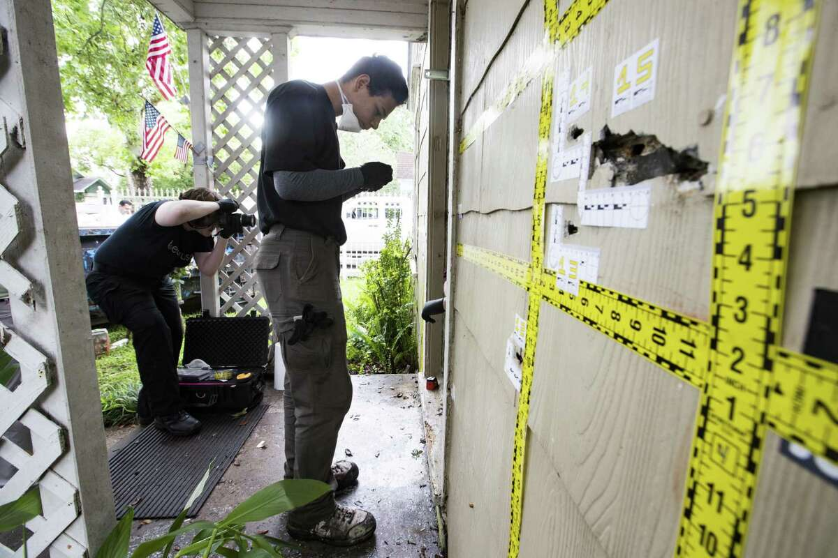 Out of state forensic team brought by the family of the killed homeowners at a botched drug raid work the bullet holes still at the home on 7815 Harding on Friday, May 10, 2019, in Houston. The home was the scene of a botched drug raid that took place on Jan. 28, 2019 and left the two homeowners dead and five police officers injured.