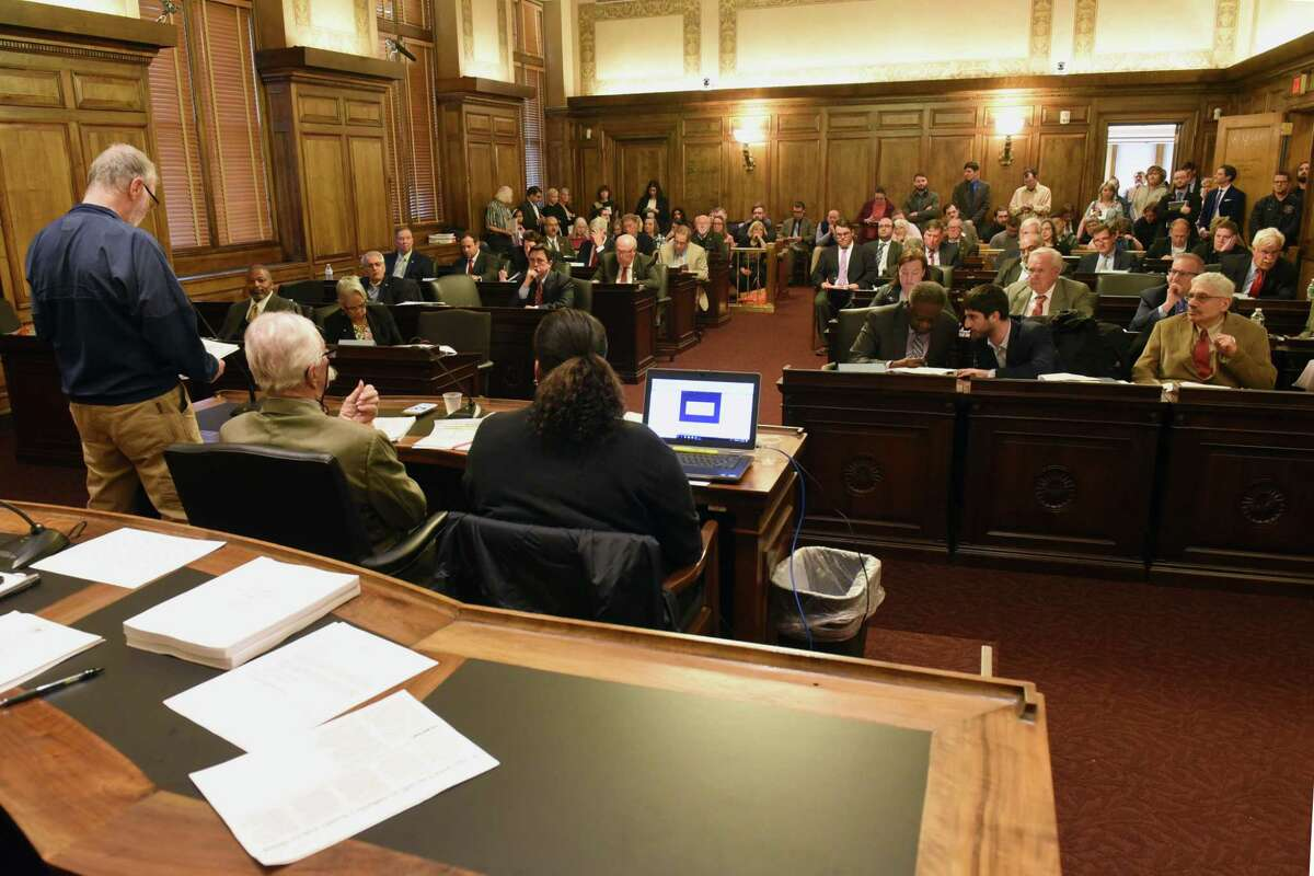 Different members of the public stand up and speak during an Albany County Legislature meeting at the Albany County Courthouse on Monday, May 13, 2019 in Albany, N.Y. One of the items on the agenda was a vote on an independent redistricting commission and process that ensures little political influence when when it comes to redrawing legislative district lines following the release of the 2020 Census. (Lori Van Buren/Times Union)