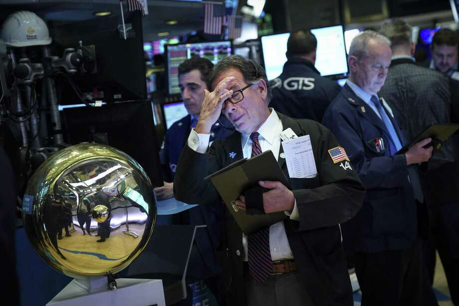 NEW YORK, NY - MAY 8: Traders and financial professionals work on the floor of the New York Stock Exchange (NYSE) ahead of the opening bell, May 8, 2019 in New York City. The Dow Jones Industrial Average fell about 33 points on Wednesday morning following a 470-point loss in the previous day's trading session. Recent volatility in the markets is driven by trade uncertainties between the United States and China. U.S. President Donald Trump said he is hopeful for a trade deal as a Chinese delegation arrives in Washington later this week for further trade negotiations. (Photo by Drew Angerer/Getty Images) Photo: Drew Angerer, Staff / Getty Images / 2019 Getty Images