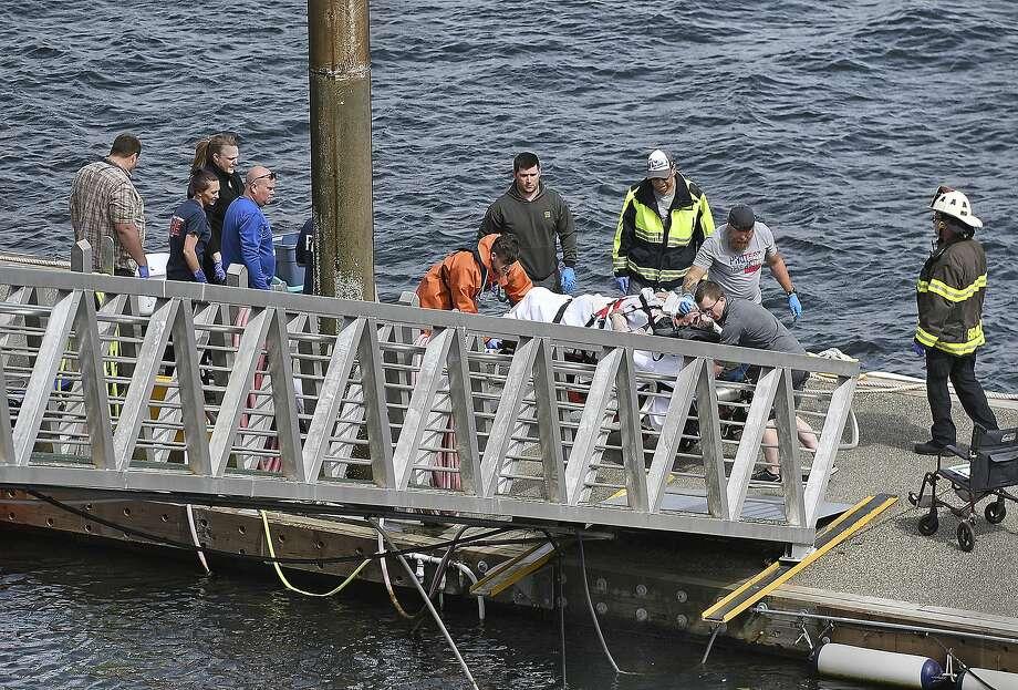Emergency responders carry an injured float plane passenger to an ambulance in Ketchikan, Alaska. Photo: Dustin Safranek / Ketchikan Daily News