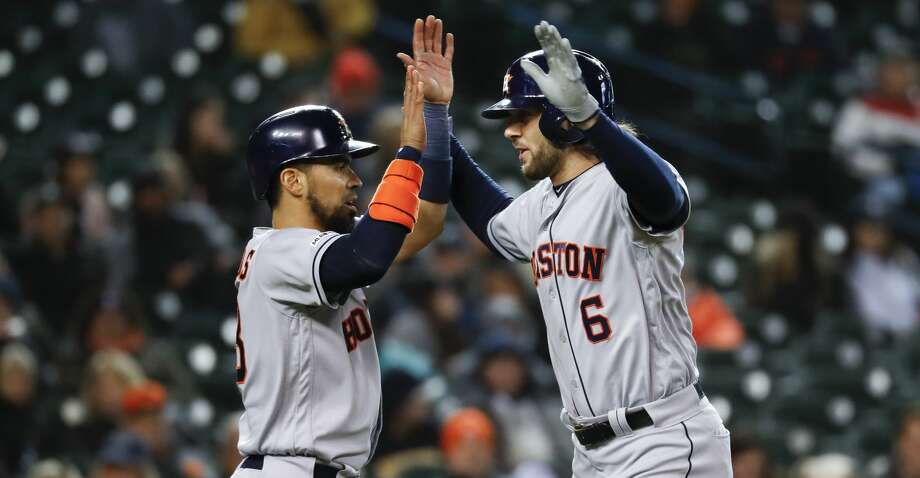 Houston Astros' Jake Marisnick (6) celebrates his two-run home run with teammate Robinson Chirinos in the seventh inning of a baseball game against the Detroit Tigers in Detroit, Monday, May 13, 2019. (AP Photo/Paul Sancya) Photo: Paul Sancya/Associated Press