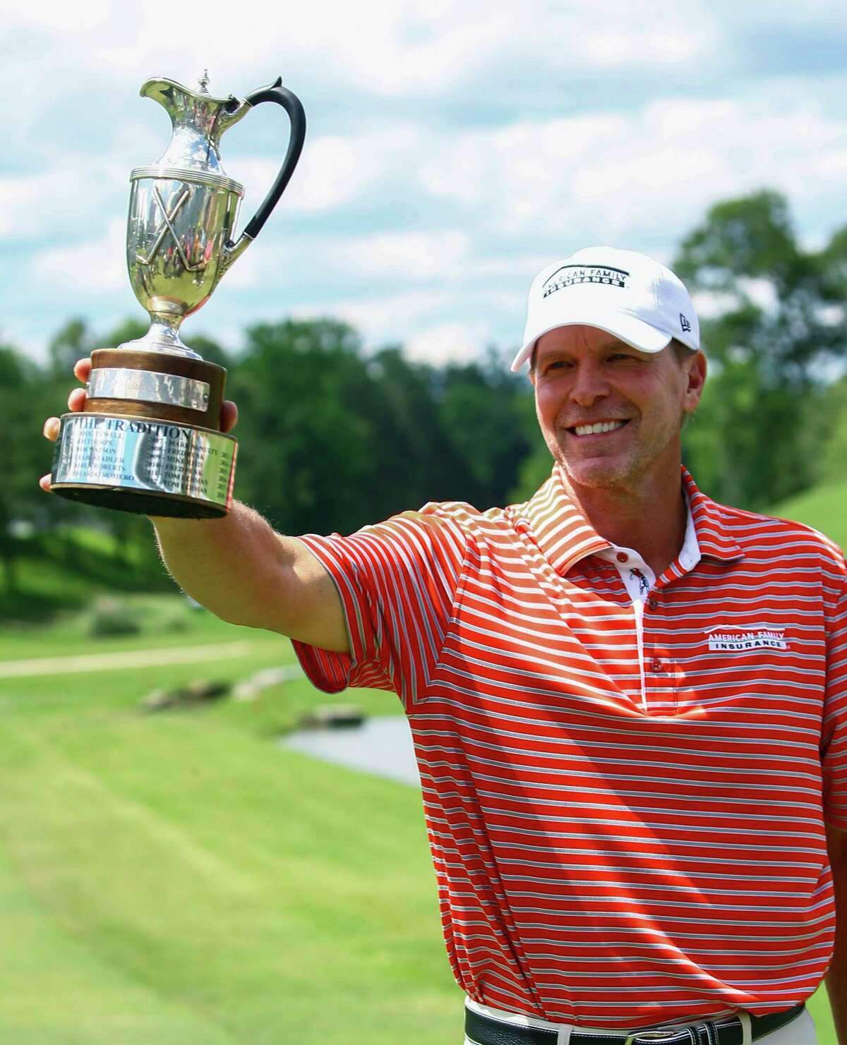 Steve Stricker holds up the trophy after winning the Regions Tradition Champions Tour golf tournament, Monday, May 13, 2019, in Birmingham, Ala. (AP Photo/Butch Dill)