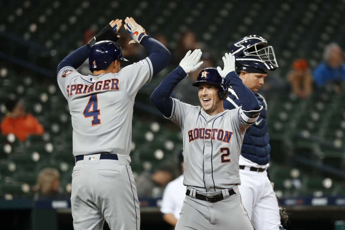 Houston Astros' Alex Bregman (2) celebrates his two-run home run with teammate George Springer (4) in the ninth inning of a baseball game against the Detroit Tigers in Detroit, Monday, May 13, 2019. (AP Photo/Paul Sancya)