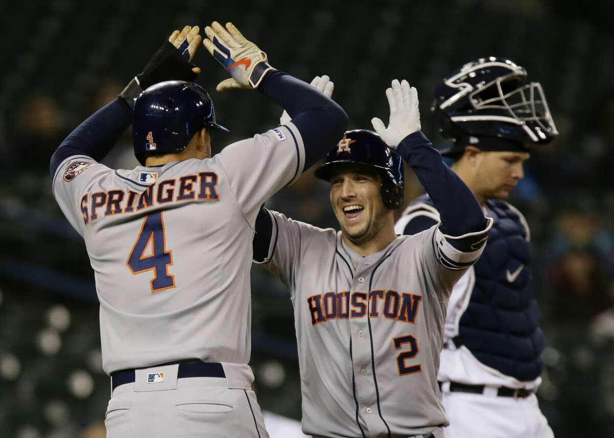 DETROIT, MI - MAY 13: Alex Bregman #2 of the Houston Astros celebrates his two-run home run with George Springer #4 against the Detroit Tigers in the ninth inning at Comerica Park on May 13, 2019 in Detroit, Michigan. The Astros defeated the Tigers 8-1. (Photo by Duane Burleson/Getty Images)