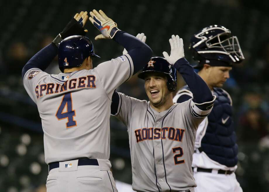 DETROIT, MI - MAY 13:  Alex Bregman #2 of the Houston Astros celebrates his two-run home run with George Springer #4 against the Detroit Tigers in the ninth inning at Comerica Park on May 13, 2019 in Detroit, Michigan. The Astros defeated the Tigers 8-1. (Photo by Duane Burleson/Getty Images) Photo: Duane Burleson/Getty Images