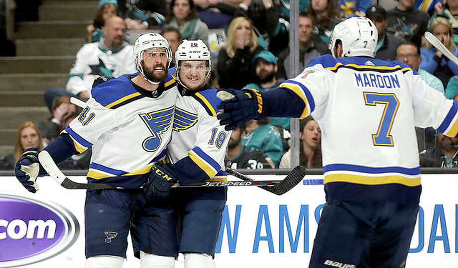 The Blues' Robert Bortuzzo, left, celebrates with teammates Robert Thomas (18) and Pat Maroon (7) after scoring a goal against the San Jose Sharks in the second period in Game 2 of the NHL hockey Stanley Cup Western Conference finals Monday in San Jose, Calif. Photo: AP Photo