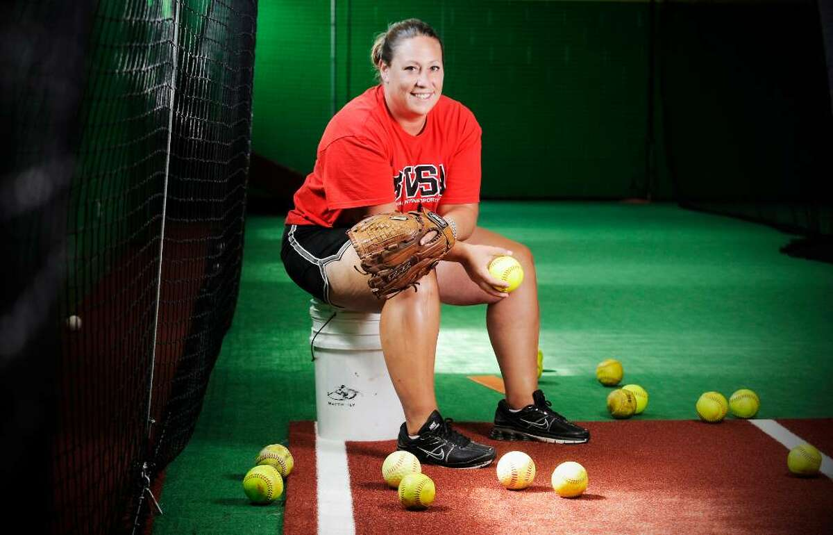 Danielle Simoneau is the new softball coach at New Canaan High School and also instructs young players at Bobby Valentine's Sports Academy in Stamford, Conn. on Wednesday June 28, 2010.