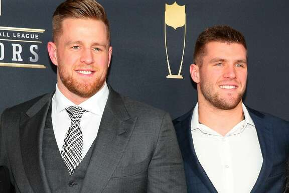 MINNEAPOLIS, MN - FEBRUARY 03:   JJ Watt and his brother TJ Watt pose for Photographs on the Red Carpet at NFL Honors during Super Bowl LII week on February 3, 2018, at Northrop at the University of Minnesota in Minneapolis, MN.  (Photo by Rich Graessle/Icon Sportswire via Getty Images)