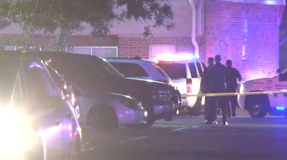 Police investigate an officer-involved shooting at a Baytown apartment complex Monday, May 13, 2019. A Baytown police officer fatally shot a woman who used his own Taser against him, police say. Photo: Metro Video, Metro Video