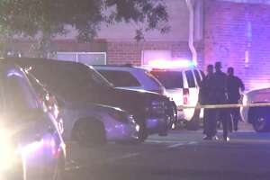 Police investigate an officer-involved shooting at a Baytown apartment complex Monday, May 13, 2019. A Baytown police officer fatally shot a woman who used his own Taser against him, police say.