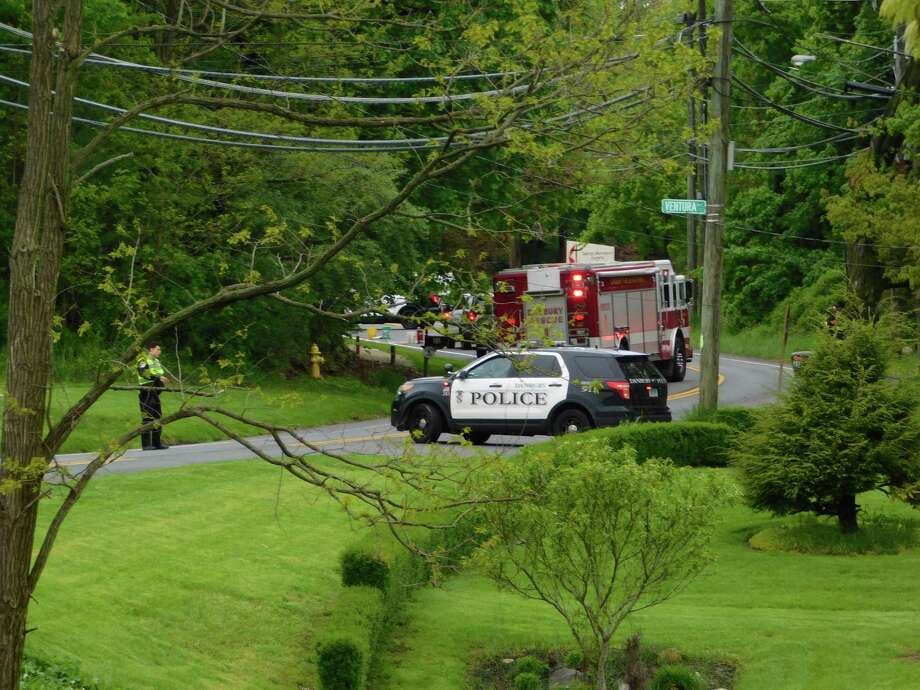 Access to Clapboard Ridge Road is blocked off near the Venture Avenue intersection Tuesday, May 14, 2019, as police, fire and EMS respond to a head-on collision. Photo: Kendra Baker / Hearst Connecticut Media