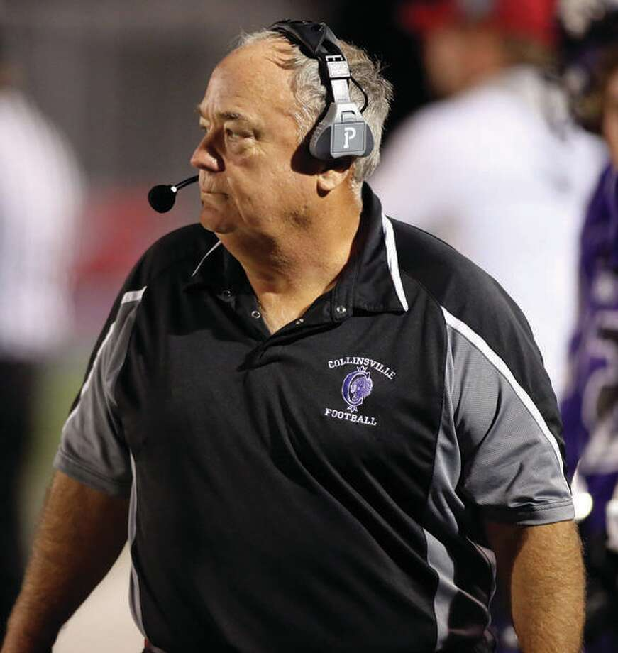 Rick Reinhart, who spent 18 seasons at Civic Memorial and one at Marquette Catholic before guiding Tuscola to one Class 1A state title and three championship-game appearances at Tuscola, was inducted into the St. Louis Metro Football Coaches Hall of Fame Monday night. Photo: Telegraph File Photo