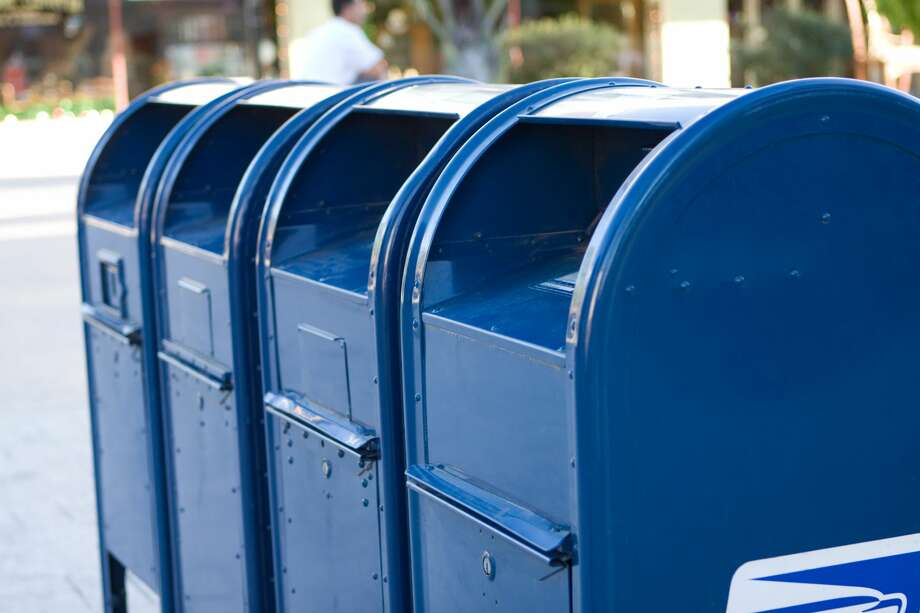 A row of blue mailboxes. Photo: Plasticsteak1/Getty Images/iStockphoto