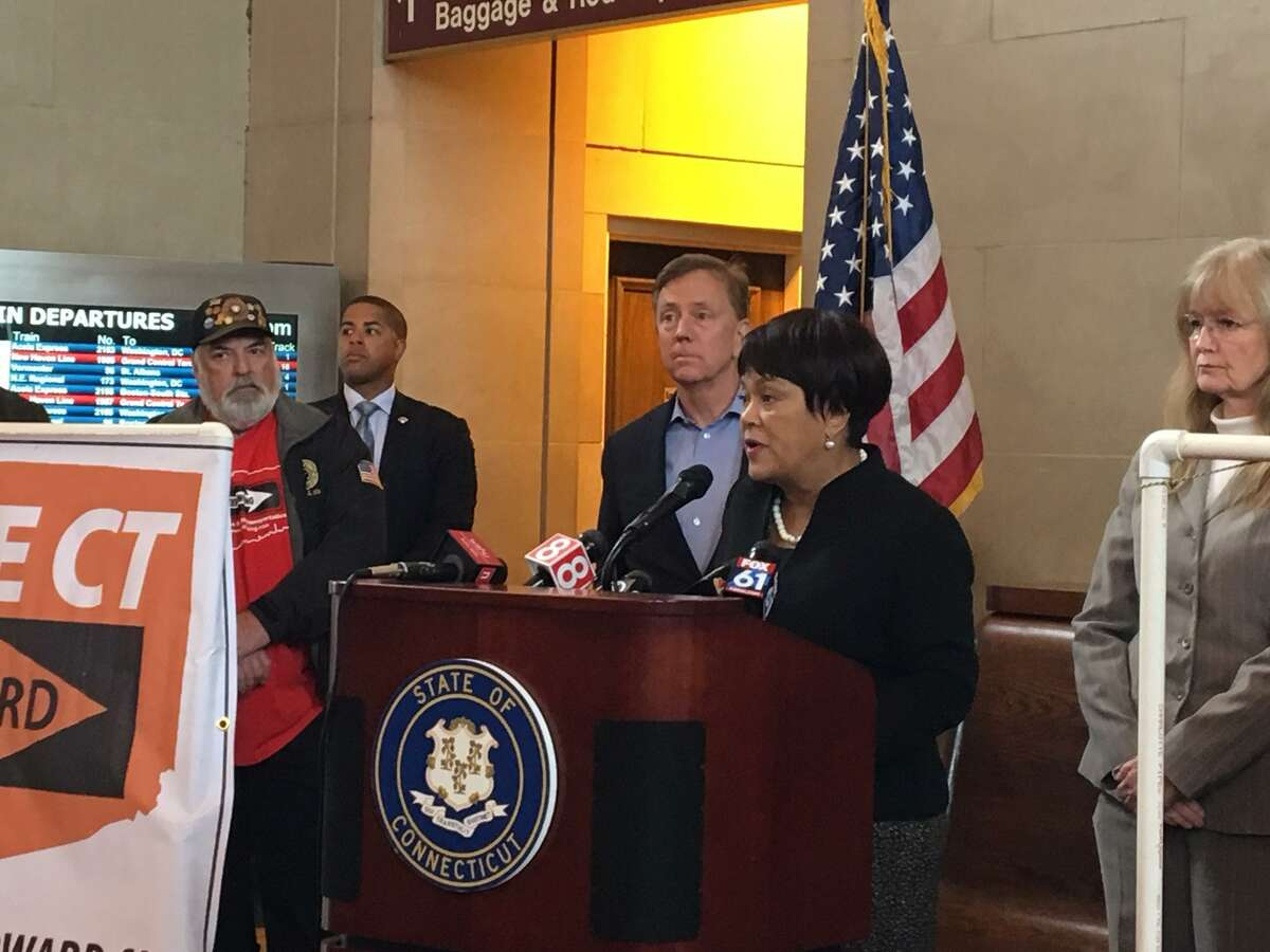 Mayor Toni Harp with Gov. Ned Lamont behind her is pushing implementation of tolls.