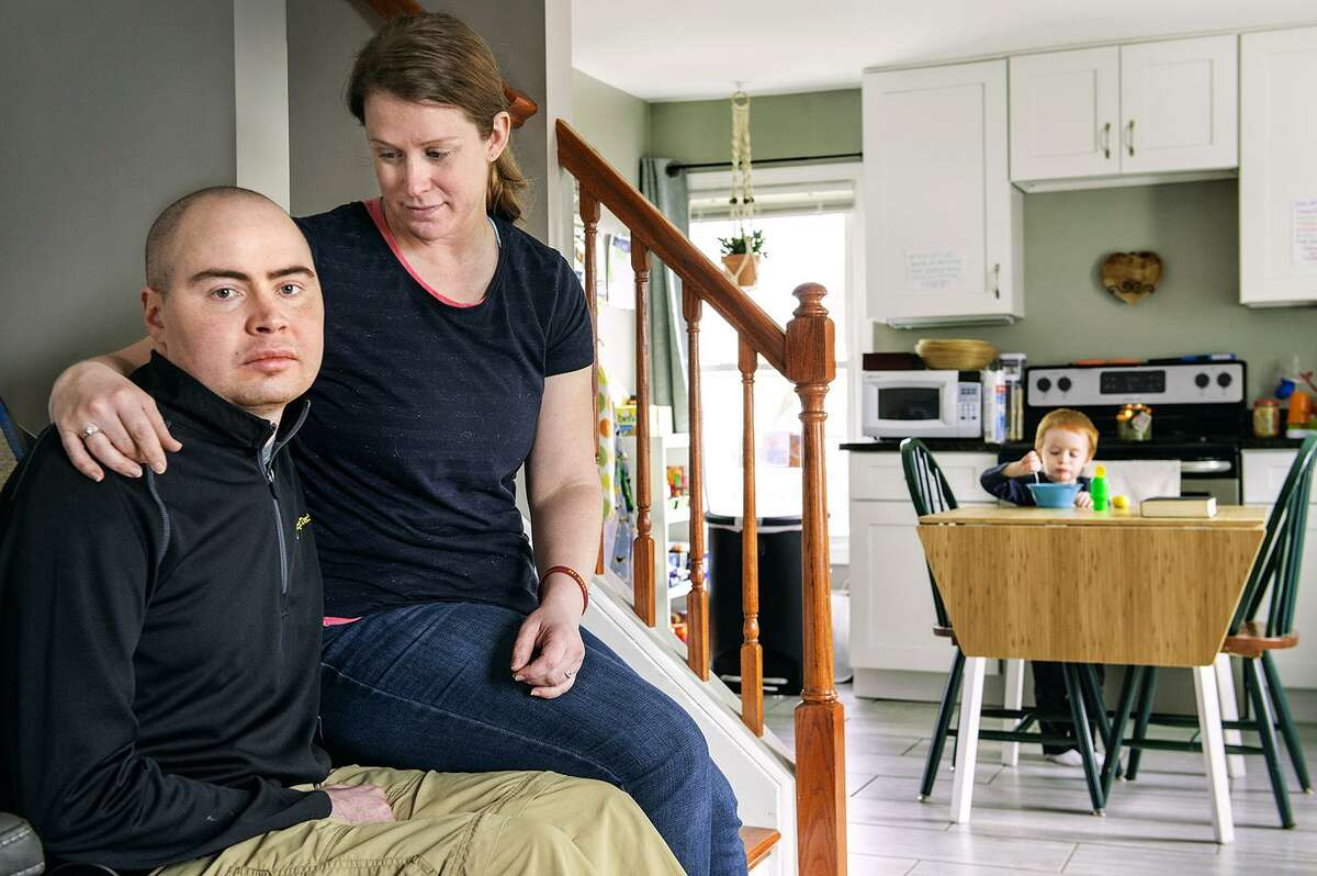 Peter and Amy Antioho in their Berlin home with their son, Mark, 3, in the background.