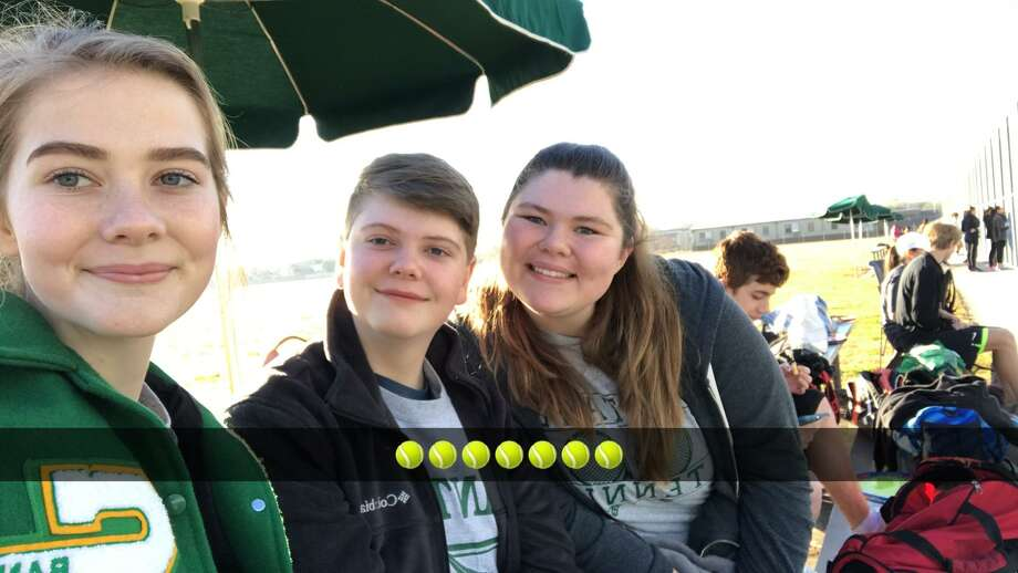 Danika McLeod poses with her brother Kyle McLeod and Shelby Jackson during a tennis match. Photo: Courtesy Danika McLeod
