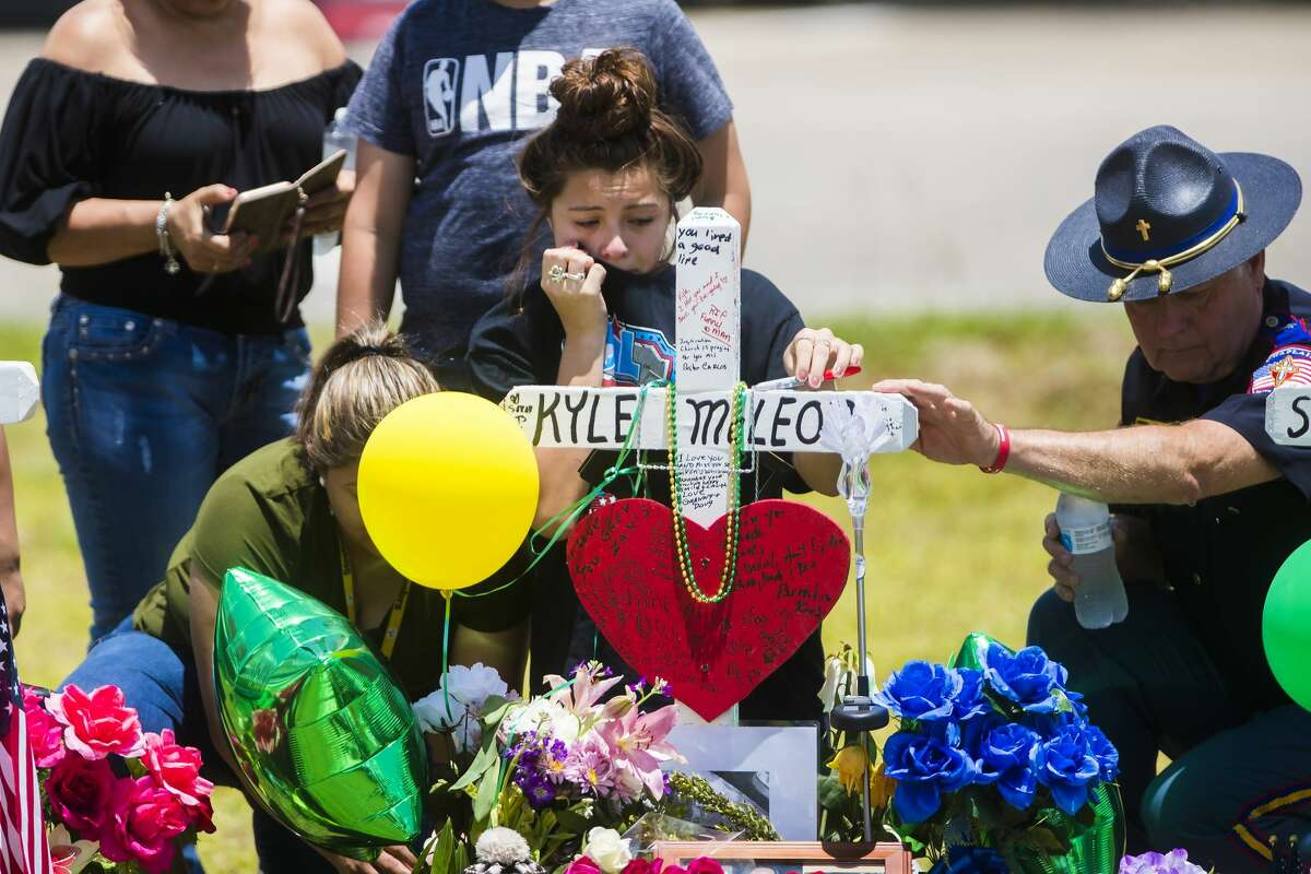 A young woman cries at Kyle McLeod's memorial May 22, 2018. McLeod was killed in the Santa Fe High School shooting.