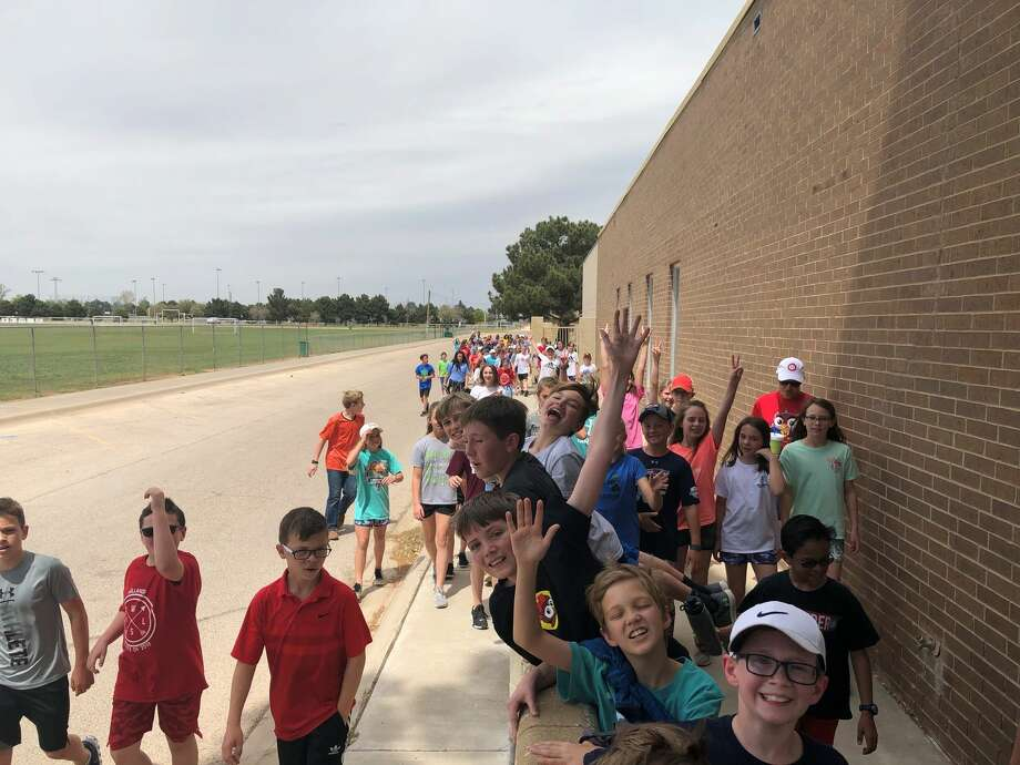 Hillander students walk over to the Midland Children's Rehabilitation Center after raising more than $30,000 to help update the MCRC sensory room. Students had lemonade stands, sold enchilada dinners, walked dogs and completed many more tasks to raise the funds. Photo: Courtesy Photo
