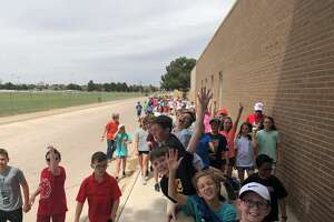 Hillander students walk over to the Midland Children's Rehabilitation Center after raising more than $30,000 to help update the MCRC sensory room. Students had lemonade stands, sold enchilada dinners, walked dogs and completed many more tasks to raise the funds.