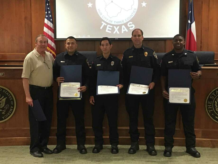 Katy Mayor Chuck Brawner recognized first responders at the May 13 Katy City Council meeting for saving the life of a 45-year-old man who experienced chest pains on April 9. From left are Brawner, Julio Garcia, Eric Bermea, Lt. Harold Haynes and Devante Minor. They are part Battalion 1, Katy Fire Department Medic 2 and Tower 1 crews who responded to the call from a Katy Independent School District building on Franz Road. The crews also included Battalion Chief Thomas R. Walters, Medic 2 Christian Kugler and Tower 1 members Joseph Theriot and Antonio Pineda. Brawner said the patient was discharged April 17 under his own will. Photo: Karen Zurawski / Karen Zurawski