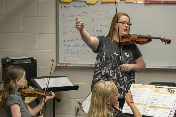 Orchestra teacher Erin DeLavan works with students at Bowie Fine Arts Academy. 05/06/19 Tim Fischer/Reporter-Telegram
