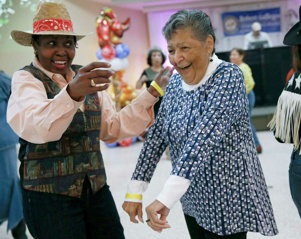 Mary Lou Gonzalez, right, dances during the fifth annual District I Senior Citizens Prom at East End Event Center in Houston on Monday, May 13, 2019. The Wild-West themed prom is hosted by Houston Councilman Robert Gallegos and featured a free brunch, dancing and a Prom King and Queen Coronation ceremony.