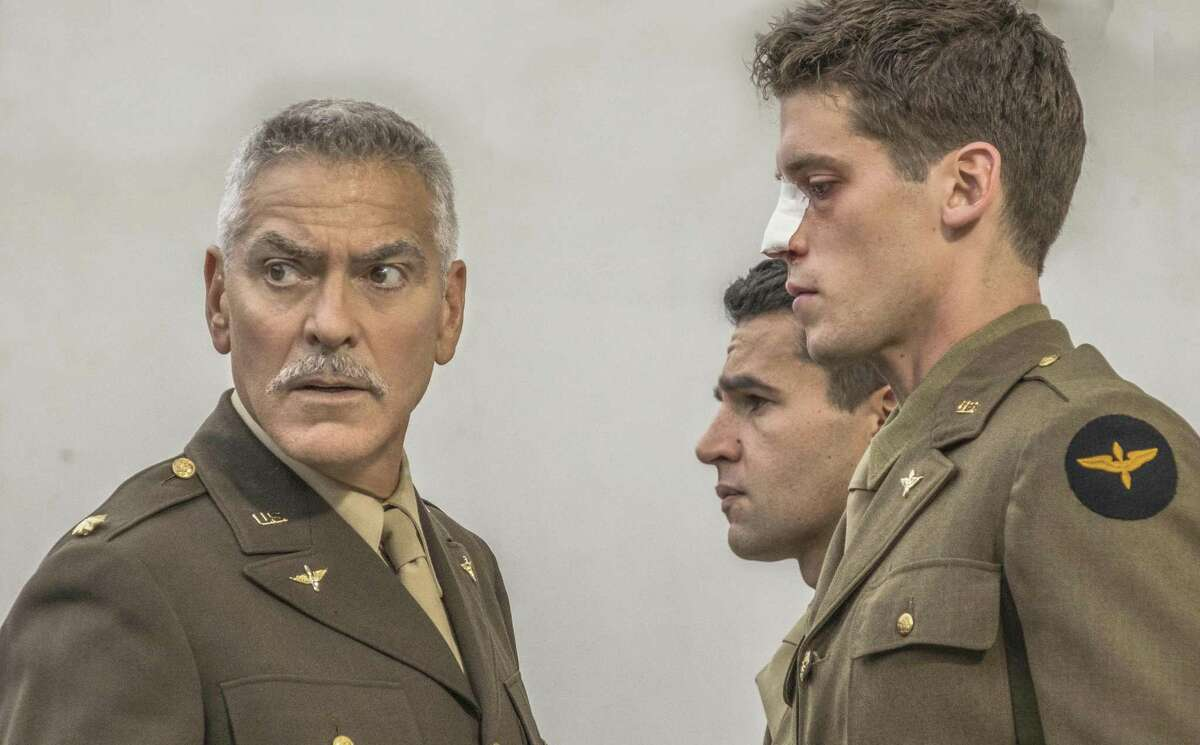 """George Clooney (left) co-produced, stars in and directs some episodes of Hulu's """"Catch-22"""" miniseries."""
