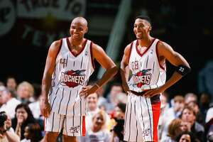 HOUSTON, TX - FEBRUARY 10:  Charles Barkley and Scottie Pippen of the Houston Rockets share a laugh during the game against the Sacramento Kings on February 10, 1999 at Compaq Center in Houston, Texas. (Photo by Sporting News via Getty Images)