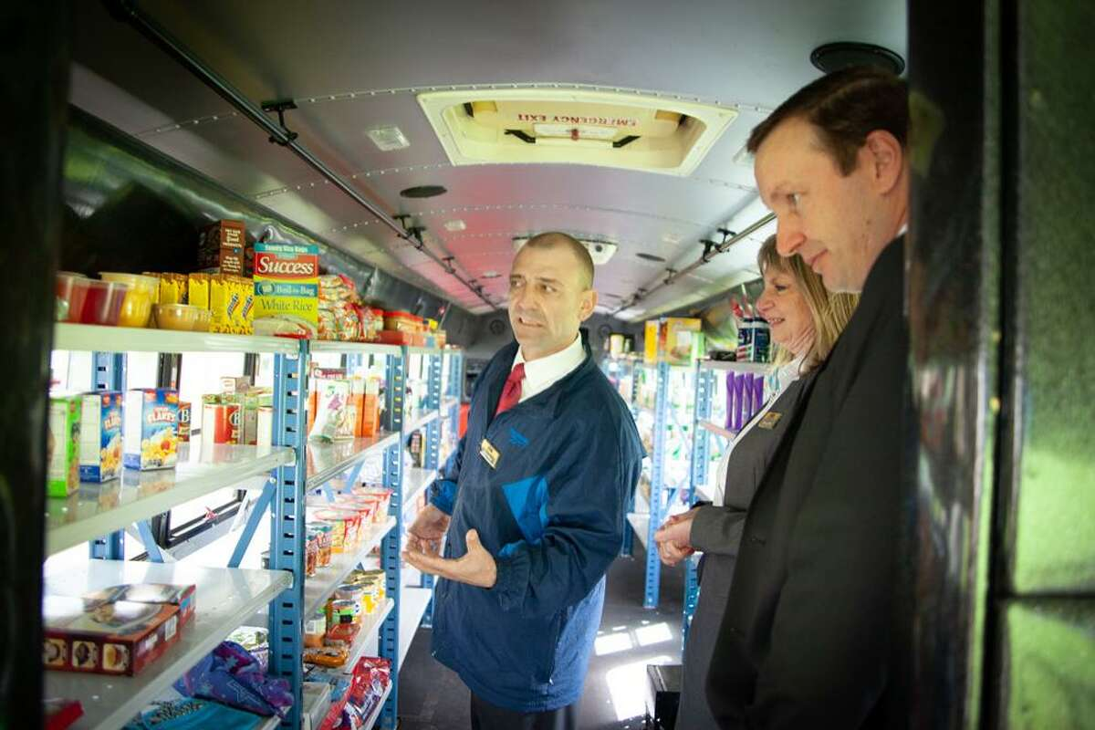 U.S. Sen. Chris Murphy took a look around Middlesex Community College's Magic Food Bus mobile pantry recently on campus in Middletown.