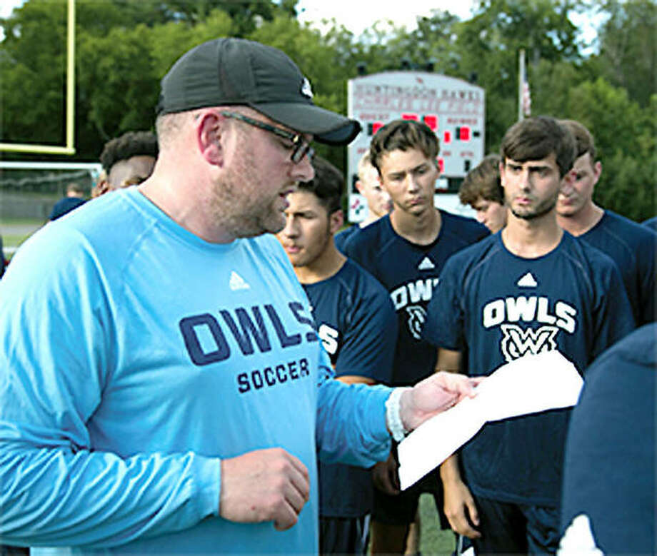 Tim Gould talks things over with his men's soccer team at the University of Mississippi for Women. Gould, a former Carlinville High coach, has been hired as the boys soccer coach at Marquette Catholic High School. Photo: 'The W' Athletics