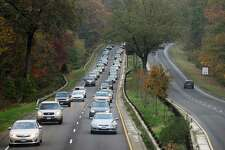 Traffic moves slowly in the southbound lanes of the Merritt Parkway toward Greenwich. In the 1980s, the state Department of Transportation considered building a monorail along the Merritt's median.
