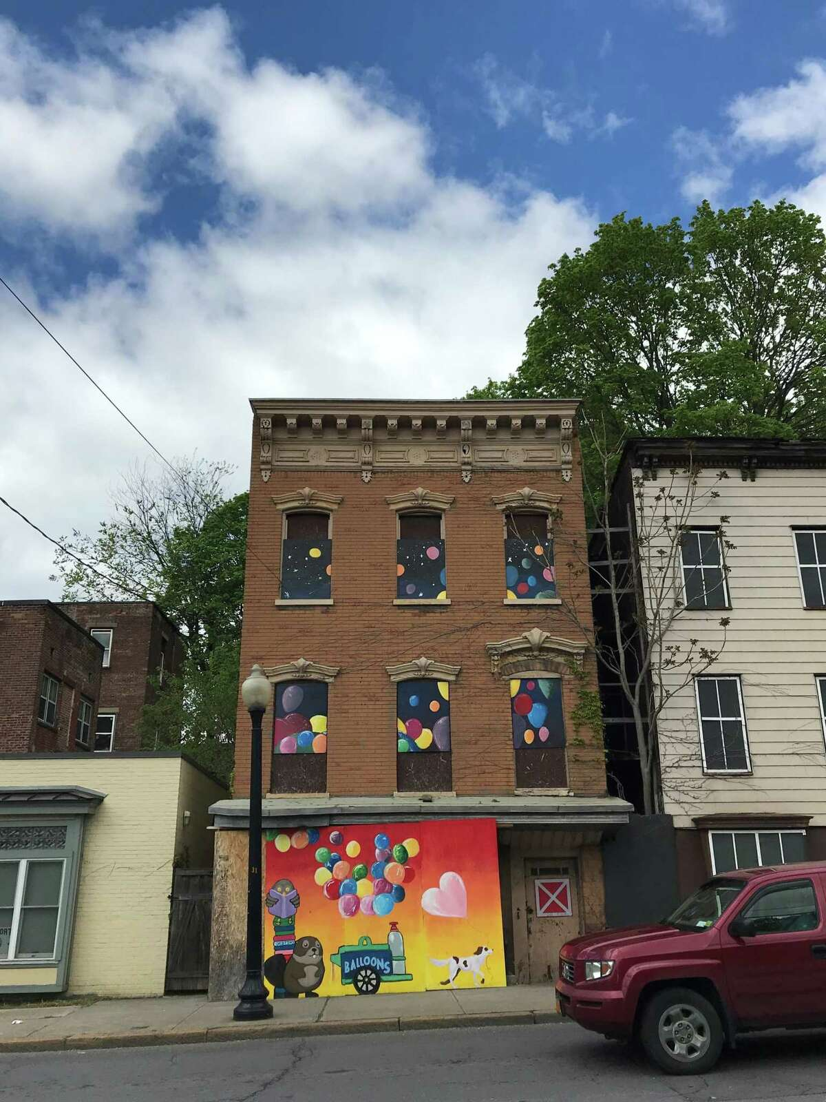 A Corner Canvas mural at 123 Henry Johnson Boulevard (photo by Amy Biancolli)